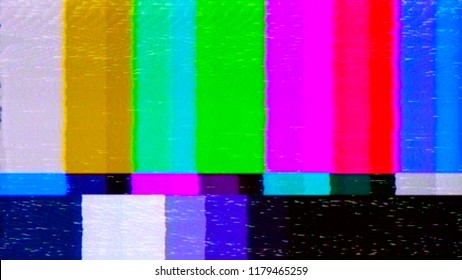 A distorted tv transmission or VHS tape, a badly eaten noisy signal of SMPTE color bars (a television screen test pattern).