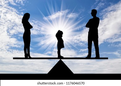 Divorce in the family. A little sad girl crying standing between mom and dad, choosing who to stay with. The concept of divorce and division of children