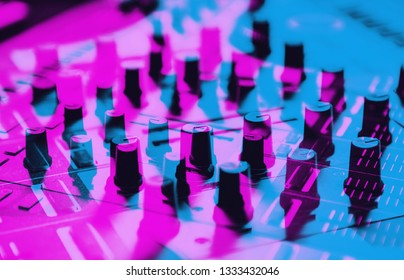 Dj midi controller device for composing new music & sound effects at party.Produce digital musical tracks with synthesizer deck.Audio equipment edited with 3d stereo effect in neon blue & pink colors