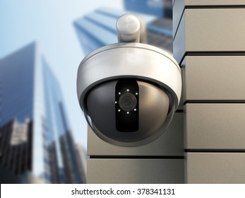 Dome camera hanging on the wall of office building.