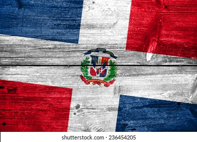 Dominican Republic Flag painted on old wood plank texture