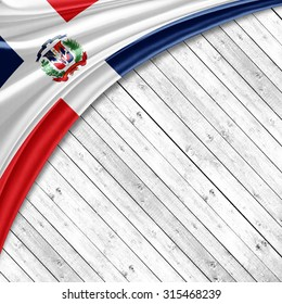 Dominican Republic flag  of silk with copyspace for your text or images and wood background