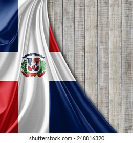 Dominican Republic flag and wood background