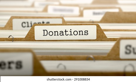 Donations Concept. Word on Folder Register of Card Index. Selective Focus.