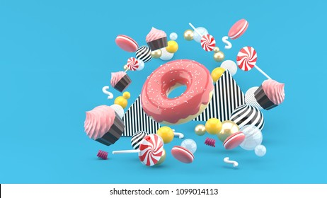 Donut ,Cupcakes ,Macaron,Candy floating among colorful balls on a blue background.-3d render.