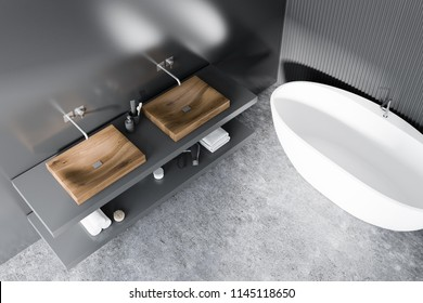 Double bathroom sink on a gray shelf standing next to a white bathtub in a room with gray walls and floor. Top view 3d rendering mock up