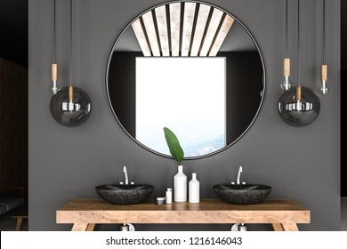 Double bathroom sink standing on wooden countertop with a big round mirror hanging above it in gray wall room. 3d rendering