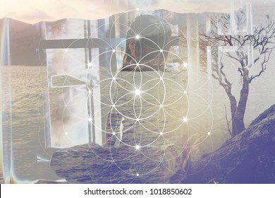 Double exposure art. Woman in meditation sitting in front of window with overlapping landscape with a tree and sacred geometry interlocking circles flower of life symbol.