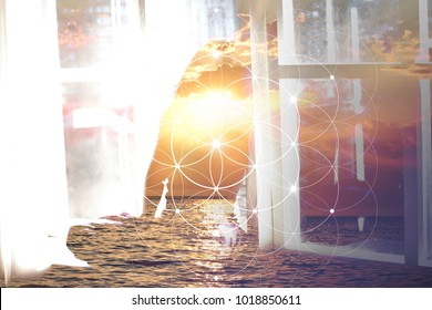 Double exposure collage with sacred geometry flower of life ancient symbol , sea, sunset and meditating female figure