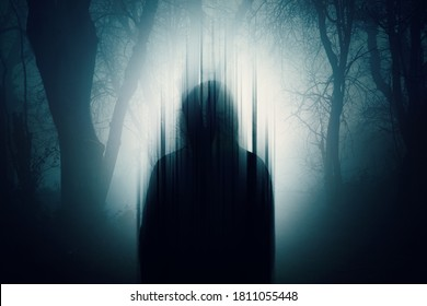 A double exposure of a Silhouette of a mysterious hooded figure without a face. Standing in a forest at night. With a glitch edit