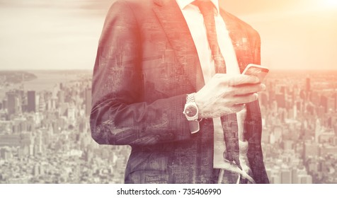 Double exposure of success business man with smart phone and city in background. Concept businessman lifestyle