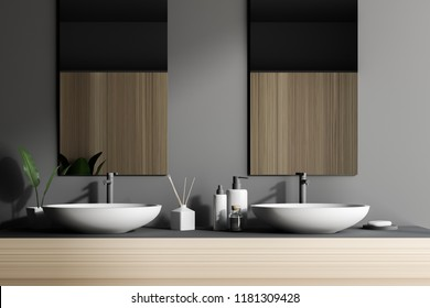 Double sink on a wooden countertop with two vertical mirrors and a shelf with folded towels. Gray walls. Concept of luxury hotel or mansion. 3d rendering copy space