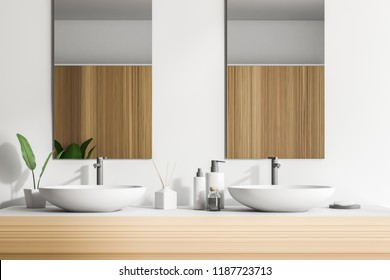 Double sink on a wooden countertop with two vertical mirrors and a shelf with folded towels. White walls. Concept of luxury hotel or mansion. 3d rendering