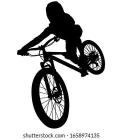 downhill mountainbiker at the jump, mtb black silhouette.