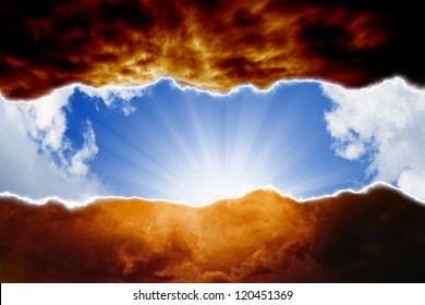 Dramatic background - sun beams in blue sky, dark red clouds, hell and heaven