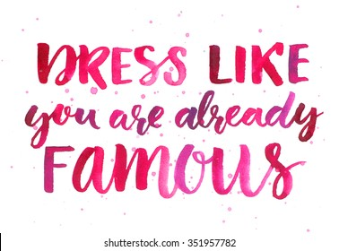 Dress like you are already famous. Inspirational quote about fashion and clothes. Pink watercolor brush lettering, custom calligraphy. Bright motivational slogan.