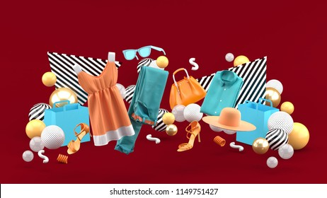Dresses, pants, sweatshirts, hats, purses, high heels and sunglasses among colorful balls on a red background.-3d rendering.