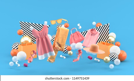 Dresses, pants, sweatshirts, hats, purses, high heels and sunglasses among colorful balls on a blue background.-3d rendering.