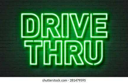 Drive thru neon sign on brick wall background
