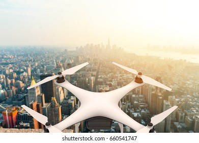 Drone with digital camera flying over a modern city at sunset: 3D rendering