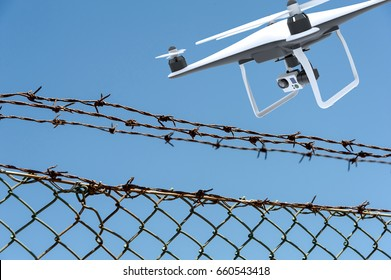 Drone with digital camera flying over a barbed wire fence: 3D rendering