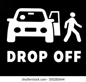 """""""DROP OFF"""" sign with illustrate of car and a man in black and white"""