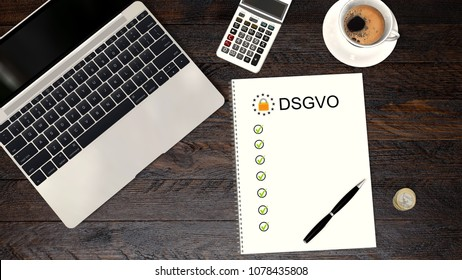 DSGVO checklist next to a laptop PC on a desk - text DSGVO on May 2018 - 3d render