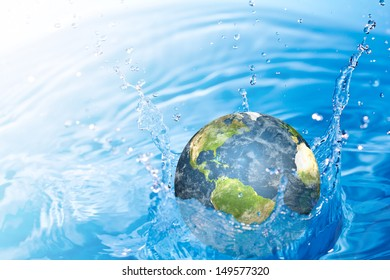 Earth falling into water  (Elements of this image furnished by NASA)