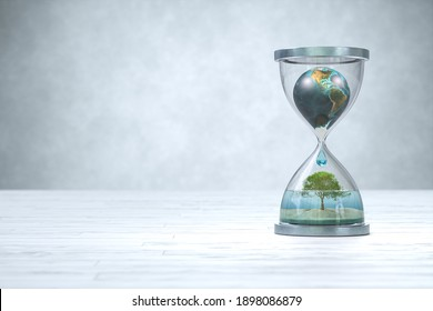 Earth planet in hourglass, Global warming concept. 3D illustration. Elements of this image furnished by NASA