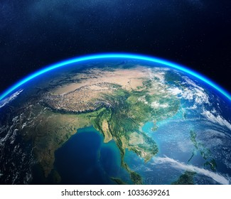 Earth viewed from space with focus on Asia. Detailed 3D render against dark starry night sky (Elements of this render furnished by NASA)
