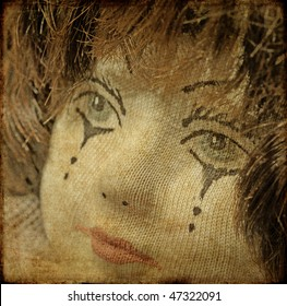 earthy background image of doll up close