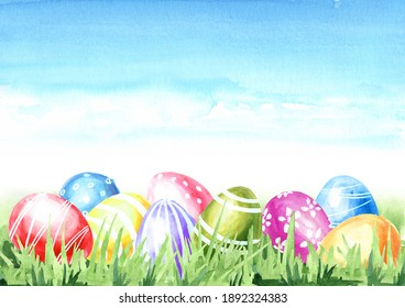 Easter Concept card background. Colored eggs in the green grass and copy space. Hand drawn watercolor illustration