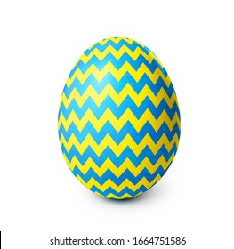 Easter egg with yellow and blue zigzag pattern isolated on white background. Clipping path included