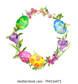 Easter wreath with easter eggs in grass and crocus flowers. Floral circle border. Watercolor