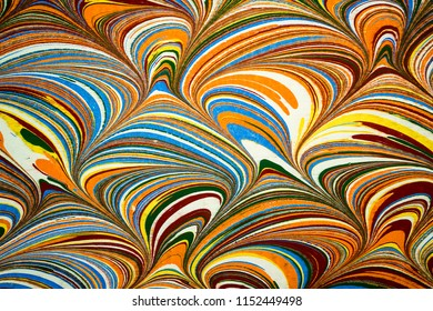 Ebru art. Traditional Turkish Ebru technique. Painting on water, followed by paper prints. Color paint ebru with waves and tile pattern.