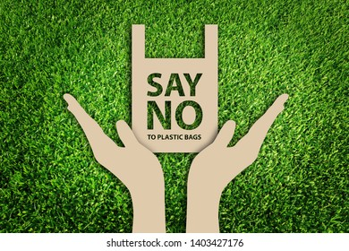 Eco bags. Say no to plastic bags. Paper cut of Eco concept on green grass background.