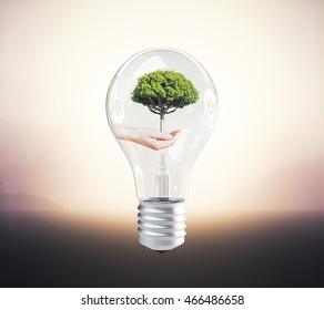 Eco concept idea with hand holding tree inside lightbulb on abstract background. 3D Rendering