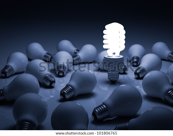 Eco energy saving light bulb , one glowing compact fluorescent lightbulb standing amongst the unlit incandescent bulbs with reflection