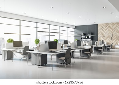 Eco style interior design in modern open space office with grey tables and chairs, wooden decor wall and concrete floor. 3D rendering