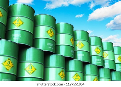 Ecology, alternative sustainable energy and environment protection saving business concept: 3D render of the group of green stacked metal biofuel drums or biodiesel barrels in the industrial storage
