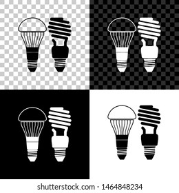 Economical LED illuminated lightbulb and fluorescent light bulb icon isolated on black, white and transparent background. Save energy lamp