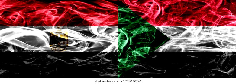 Egypt, Egyptian vs Sudan, Sudanese smoke flags placed side by side. Thick abstract colored silky smoke flags