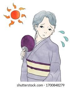 着物を着た年配の女性は汗をかいている。