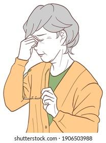 視力がぼやけて苦しむ老人。