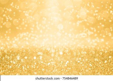 Elegant gold glitter sparkle confetti background for golden happy birthday party invite, 50 wedding anniversary, glitz and glam, fun dance celebration, Christmas ad or New Year's Eve champagne texture