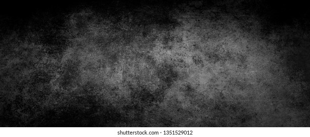 Elegant grainy black background with marbled or crackled stone texture in an old vintage design, dark charcoal gray color backdrop