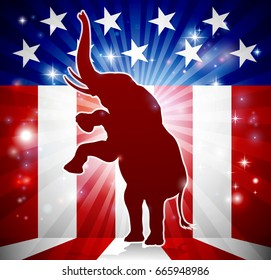 An elephant in silhouette rearing on hind legs with an American flag in the background republican political mascot