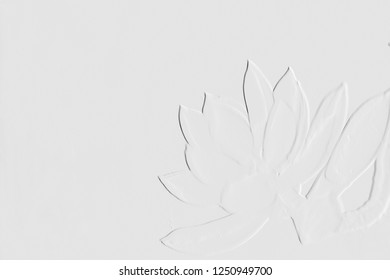 Embossed leaves and flowers with light grey background