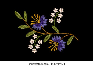 Embroidered satin stitch wavy sprig with purple cornflowers and delicate white  flowers on black background
