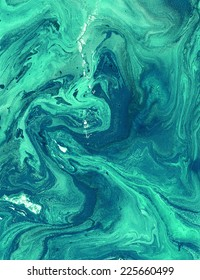 Emerald abstract background with painted waves. Beautiful texture. Liquid paint.